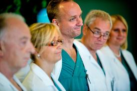 From left specialist surgeons Andreas G Tzakis, Pernilla Dahm-Kähler, Mats Brannstrom, Michael Olausson and Liza Johannesson attend a news conference Tuesday Sept. 18, 2012 at Sahlgrenska hospital in Goteborg Sweden. Two Swedish women are carrying the wombs of their mothers after what doctors called the world's first mother-to-daughter uterus transplants. The specialists at the University of Goteborg completed the surgery over the weekend without complications, but say they won't consider the procedures successful unless the women achieve pregnancy after their observation period ends a year from now. (AP Photo/Adam Ihse)